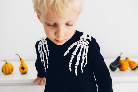 Closeup of boy dressed as skeleton pirate for Halloween