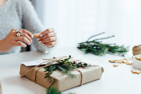 Woman packing Christmas gifts presents