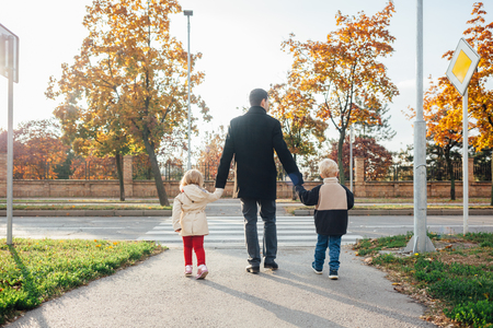 exceeds: Father with children exceeds the pedestrian crossings
