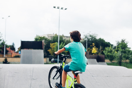 skate park: Boy riding bike in the skate park Stock Photo
