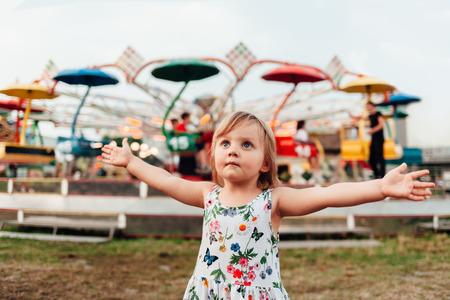 Little girl enjoying in luna park Stock Photo