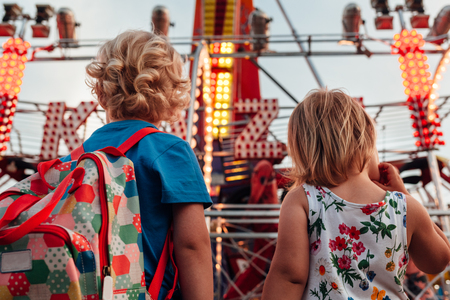 Little girl and boy looking at kamikaze in luna park Stock Photo