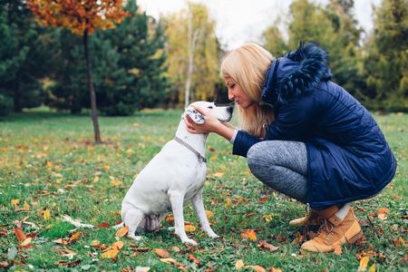 endear: Beautiful woman kissing his dog Stock Photo