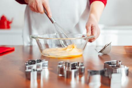 whisking: Chef whisking eggs for cakes