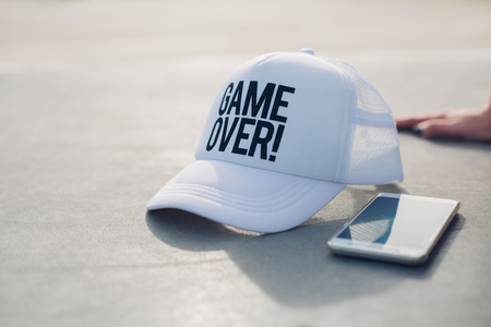 silver: Sports equipment, game over cap and mobile phone Stock Photo