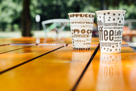 Closeup of two cups of coffee with copy space on wooden table