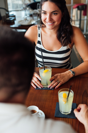 Closeup of couple drinking in a cafe Stock Photo