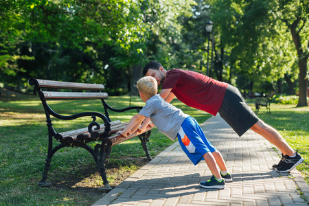 Father and son workout in the park Stock Photo