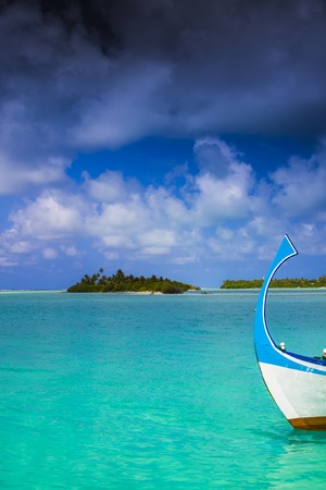 maldivian: dark clouds over an maldivian island with a boat in front of Stock Photo