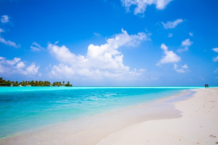 endless beach and view to a tropical island