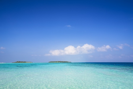 dyllic: background of a tropical island in a turquoise sea with blue sky