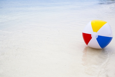 background with a beach ball in the water