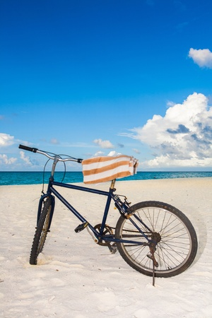 mountain bike with a towel at the beach photo