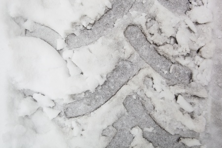 background of truck tracks on a snowy and icy grey surface photo