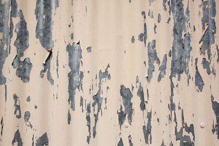 spall: background of corrugated sheet iron metal with chipped off fawn color