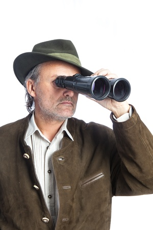 elder german hunter searching game with his binoculars photo