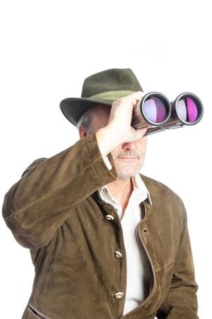 elder german hunter searching prey with his binoculars Stok Fotoğraf