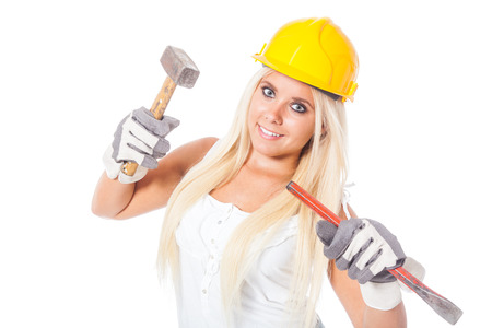 gouge: sexy young blonde girl working as a building labor with protection helmet, hammer and gouge or chisel Stock Photo
