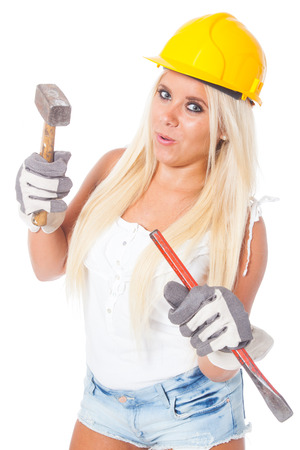 gouge: sexy young blonde girl working as building labor with a yellow helmet, hammer and chisel or gouge Stock Photo