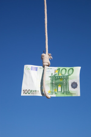 gibbet: one hundred Euro banknote hanging in the air at a  gibbet cord: Concept for Euro crisis, financial benefit or trap