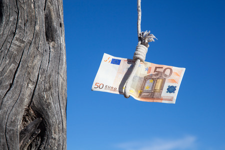 gibbet: one fifty Euro banknote hanging in the air at a  gibbet cord: Concept for Euro crisis, financial benefit or trap