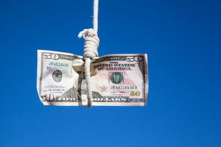 gibbet: one fifty Dollar banknote hanging in the air at a  gibbet cord: Concept for Dollar crisis, financial benefit or trap    Stock Photo