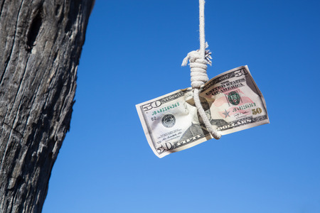 recompense: one fifty Dollar banknote hanging in the air at a  gibbet cord: Concept for Dollar crisis, financial benefit or trap    Stock Photo