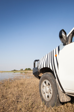 4 wheel: white 4x4 car at the bank of Chobe river front National Park, Botswana, Africa Stock Photo