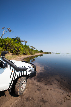 4 wheel: white 4x4 car at the muddy bank of Chobe river front National Park, Botswana, Africa Stock Photo