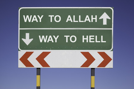 fundamentalism: green traffic sign in front of a blue sky, horizontal arrows showing two directions and a red white road warning post. Religious concept for belief: Choose between Allah and hell.