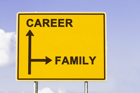 yellow traffic sign with arrows in two directions. One arrow shows the way to career, the other the way to family, concept for deciding between business job and private life photo