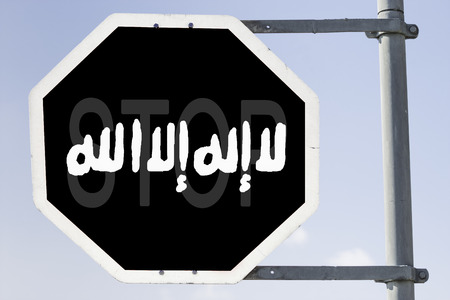 testimony: black painted stop sign which looks like the banner of islamic state in the center is written  shahada in arabic letters, which means testimony. Concept for: Stop the IS or stop entering Islamic State