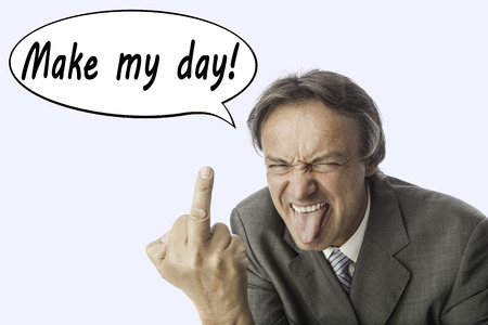 business for the middle: elder mad business man in a grey suite poking one´s tongue and showing his middle finger. In a speech balloon are written the words: Make my day. Concept for anger aand stress. Stock Photo