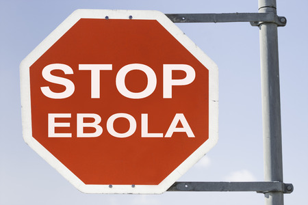 exitus: red stop sign with the words stop EBOLA. Concept against spreading Ebola infection and disease