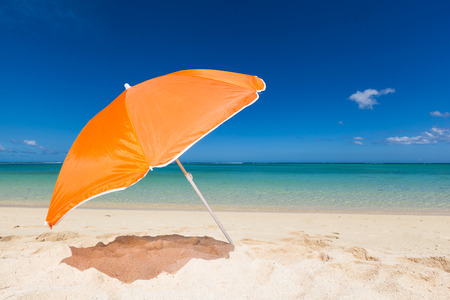 beautiful beach with an orange sunshade, turquoise sea, blue sky and white sand, Mauritius, Africa Zdjęcie Seryjne