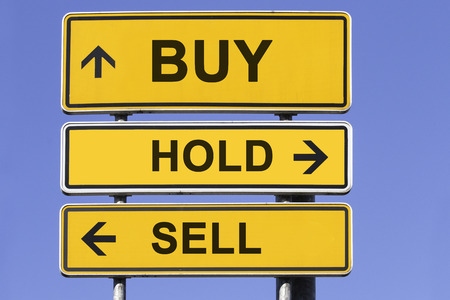 three yellow signs with arrows  in front of a blue sky showing the ways to buy, keep or sell. Concept for financial investment Standard-Bild
