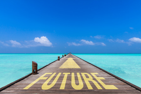 proceeding: endless jetty with an yellow arrow  leading over a turquoise sea  to the horizon. On the jetty is written the word future. Concept for proceeding to future.