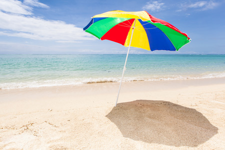 lonesome: colorful sunshade at a lonesome tropical beach, Le Morne, Maurtius, Africa