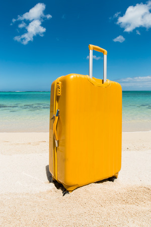 residual: yellow trolley standing in the sand of a beautiful beach with a turquoise sea Stock Photo