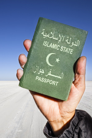 internationally: white sand of the Sahara desert in th background and a male hand holding a green passport with a white half moon and star. The words islamic state and passport are written in arabic and english language