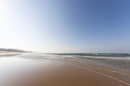 lonesome: travel background with a lonesome endless beach in South Africa