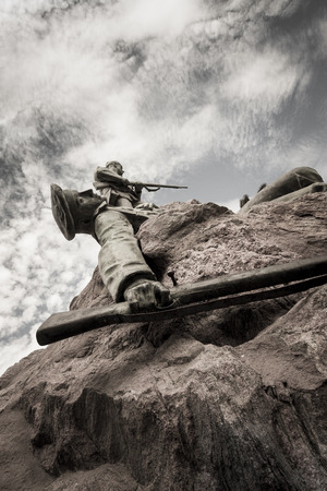 german soldier: Killed soldier with gun on the rock of the Marine monument, remembering the German soldiers killed during the Herero rebellion 1904-1905, Swakopmund, Namibia, Africa