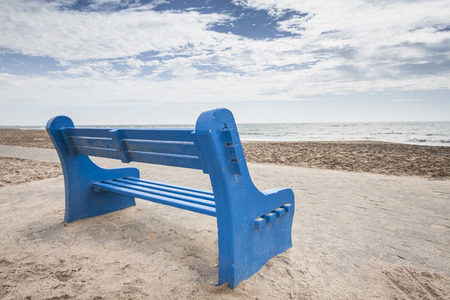 rest in peace: blue bench at a lonesome beach, concept for rest, relax and peace, Swakopmund, Namibia, Africa