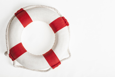 retrieval: red and white lifesaver on a white background concept and symbol for security and danger Stock Photo