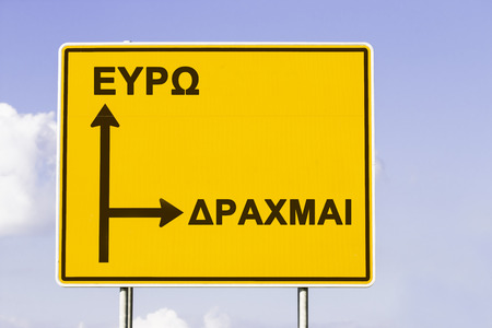 greek currency: Yellow European direction sign, showing the way to Euro and to the old currency Drachma. Financial concept for the greek debt crisis with the words Euro and Drachma in greek letters.