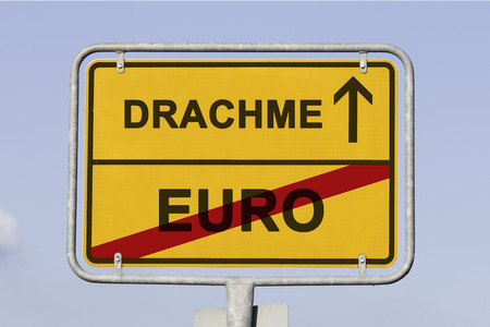 greek currency: yellow european town sign, showing that Greece is  leaving the Euro and is on the way launching the old currency Drachma. Financial concept for the greek debt crisis and the german word Drachme