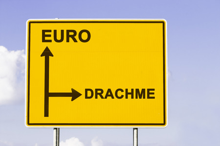 greek currency: yellow european direction sign, showing the way to Euro and to the old currency Drachma. Financial concept for the greek debt crisis with the german word Drachme Stock Photo