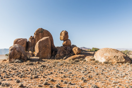 rock formation of red granite stone in the Namib desert, Namibia Africa