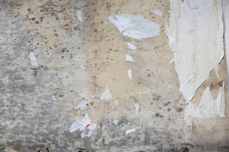 tattered: background of an old grungy wall with tattered wallpaper Stock Photo