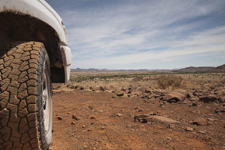 tyre of a off road car in the red sand of the Kalahari desert, Namibia, Africa